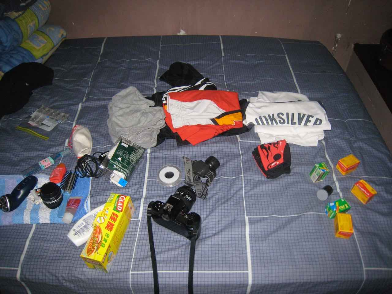 picture showing the packing items for a cycling tour