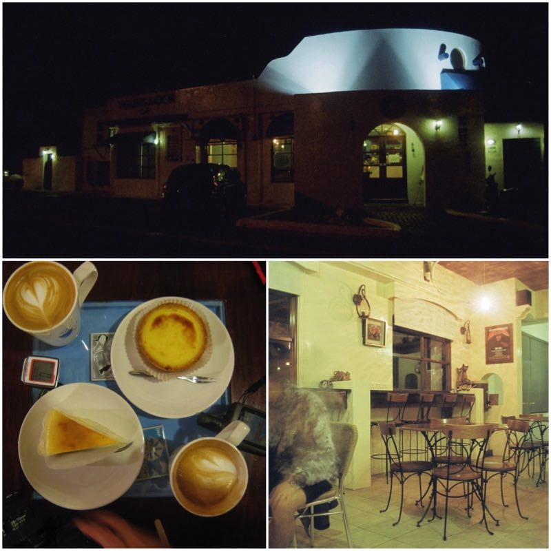 A cafe in the evening, a table and cheese cakes.