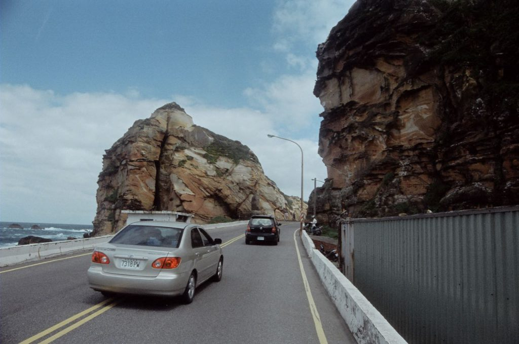Cars on Road and Colourful Rock Formation