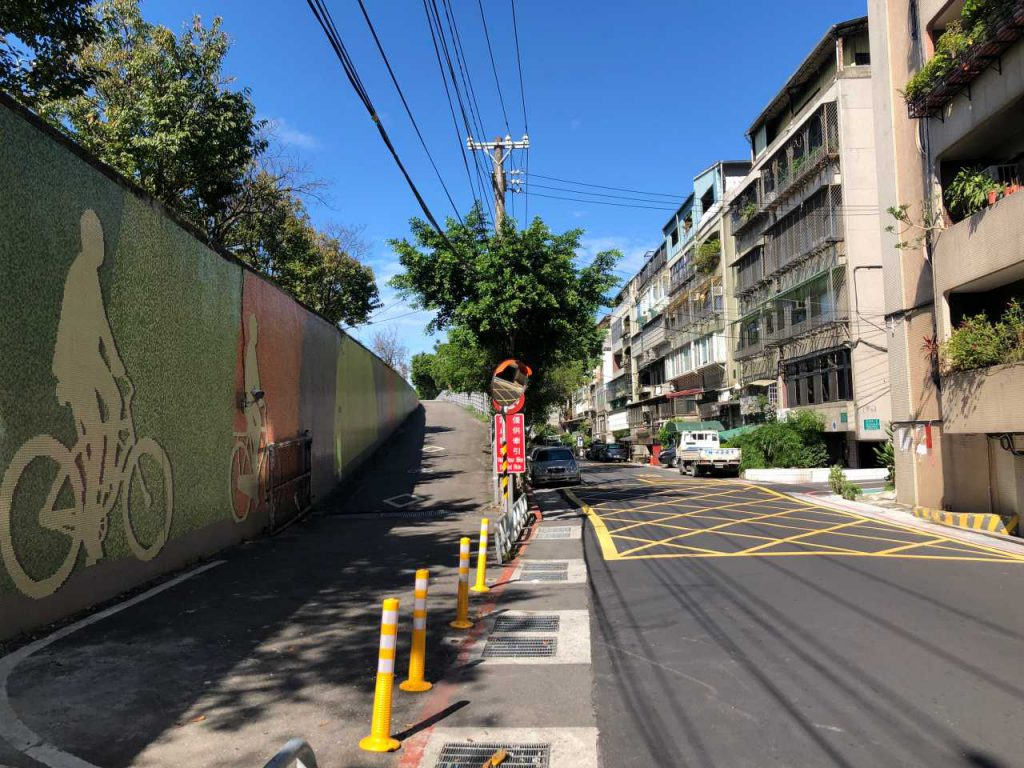 Another style of ramp for bikes to pass the wall and access the riverbank bikeways